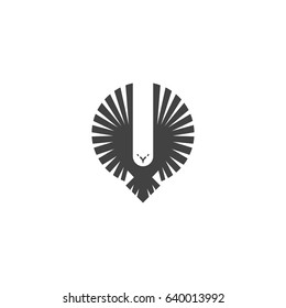 Eagle logo, emblem of a flying hawk hunter, silhouette of a bird of predator with wings directed upwards in the style of negative space, design element template for printing on a T-shirt.