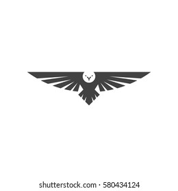 Eagle logo, silhouette predator hawk bird wide wingspan floating in the air, flying animal tattoo emblem mockup.