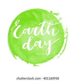 Earth day white hand written inscription on green round watercolor background