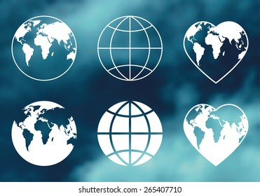 Earth symbols on blurred background. Globes icons.  Vector set.