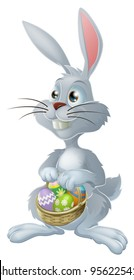 The Easter bunny with a basket full of painted Easter eggs