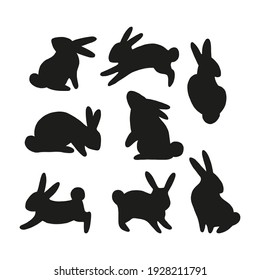 Easter bunny black silhouette collection. Rabbit in different positions clipart set isolated on white background. Farm animals shape design elements.