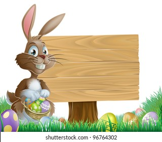 The Easter bunny holding a basket of Easter eggs with more Easter eggs around him by a wood sign board