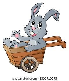 Easter bunny in wheelbarrow image 1 - eps10 vector illustration.