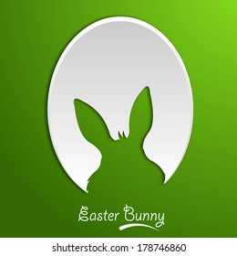 Easter egg cutout on green background.