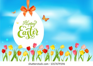 Easter eggs, batterflies and blue sky. Holiday seasonal spring background. Template with space for text.