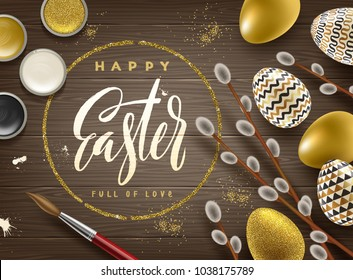 Easter greeting illustration. Pussy-willow branches, paint decorated eggs and glitter gold frame with brush calligraphy greeting on a wooden desktop.