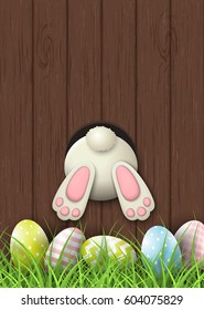Easter motive, white bunny bottom and easter pink and green eggs and fresh grass on brown wooden background, vector illustration, eps 10 with transparency and gradient meshes