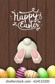 Easter motive, white bunny bottom and easter eggs on dark brown wooden background with text Happy Easter, vector illustration, eps 10 with transparency and gradient meshes