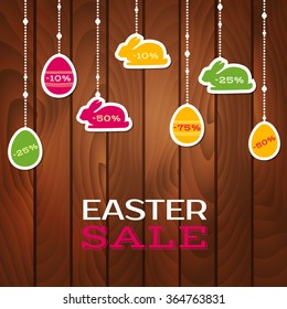 Easter sale poster with hanging price stickers on a wooden background