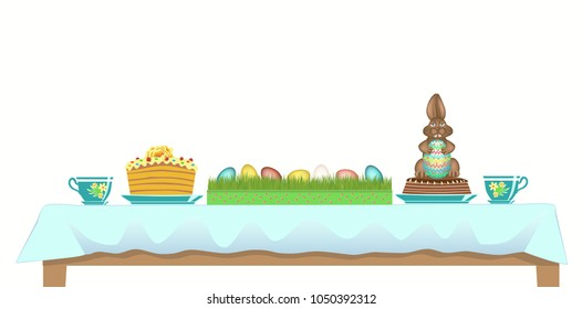 Easter table served with chocolate Bunny, traditional cake and tea cups. Colorful eggs in gift box with grass.