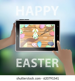 Easter vector. Illustration for your design. Tablet smart phone in human hands. Funny rabbit - an egg on the background of a wooden table. Color hand with brush