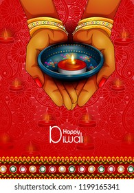 easy to edit vector illustration of lady holding decorated diya for Happy Diwali holiday background