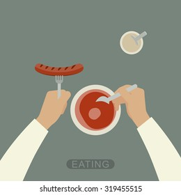 Eating process. Hands holding spoon and fork with sausage.