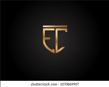 EC shield shape Letter Design in gold color