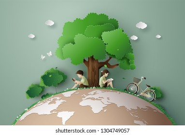 Eco and environment concept  with children read a book under the big tree,Paper art 3d from digital craft style.