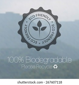 Eco friendly design against blurred mountain background.
