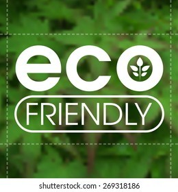 Eco friendly label against blurred green leafy background.