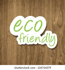 Eco friendly sign on wooden background