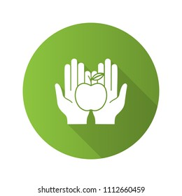 Eco products flat design long shadow glyph icon. Food donation. Healthy nutrition. Organic food. Open palms with apple. Vector silhouette illustration