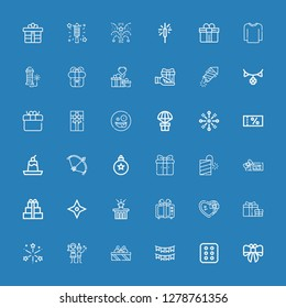 Editable 36 xmas icons for web and mobile. Set of xmas included icons line Bow, Cracker, Garlands, Gifts, Christmas party, Fireworks, Gift, Star, Voucher, Petard on blue background