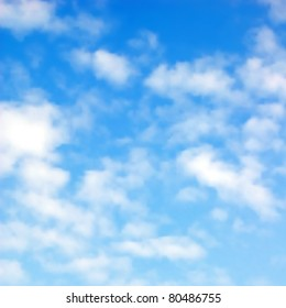 Editable vector illustration of fluffy white clouds in a blue sky made using a gradient mesh