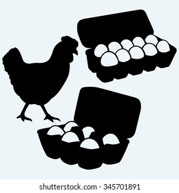 Eggs in a carton package and chicken. Isolated on blue background. Vector silhouettes