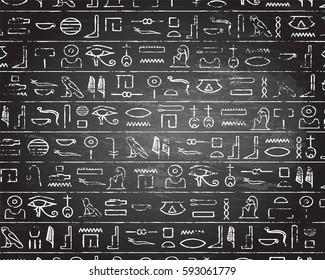 Egyptian hieroglyphics on blackboard background