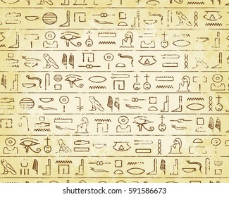 Egyptian hieroglyphics on faded parchment background