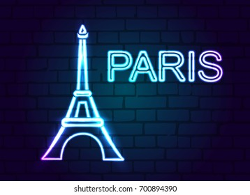 Eiffel tower blue glowing neon against a brick wall with the inscription Paris.