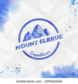 Elbrus logo. Round expedition blue vector insignia. Elbrus in Caucasus, Russia outdoor adventure illustration. Climbing, trekking, hiking, mountaineering and other extreme activities logo template.