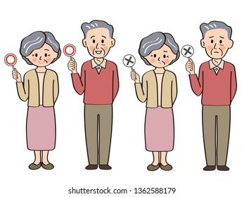 Elderly couple answering the quiz