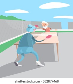 elderly couple engaged in sports - playing table tennis (ping-pong)