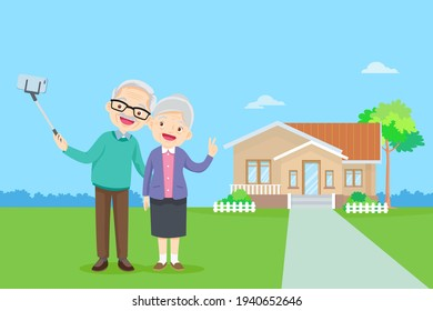 elderly couple and making photo together on mobile phone with selfie stick.Old man and woman take selfie on smartphone in front of home