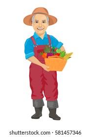 elderly male gardener wearing overalls carrying basket of fresh vegetables