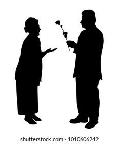 An elderly man gives a rose to an elderly woman