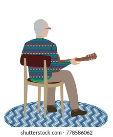 An elderly man in a Norwegian patterned sweater plays a guitar facing his back
