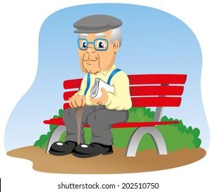 elderly sitting on the park bench