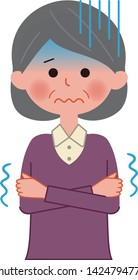 An elderly woman is shivering with cold.