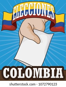 Electoral campaign with  ribbon like Colombian flag with hand, electoral card and box to promote the suffrage in Colombia next election contest (written in Spanish).