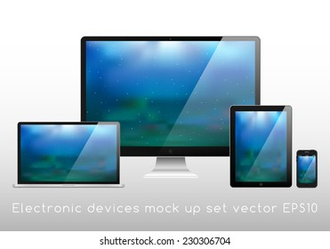 Electronic devices mockup set - laptop, monitor, tablet and smartphone vector illustration