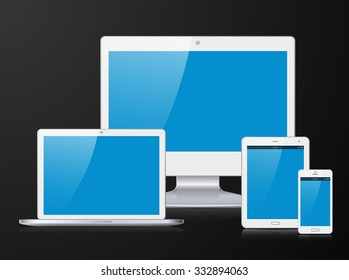 Electronic silver devices with blue, shiny screens isolated on black background; desktop computer, laptop, tablet and smartphone