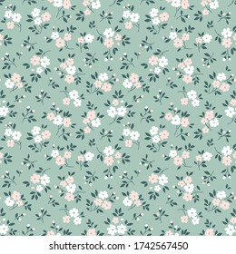 Elegant floral pattern in small pale pink and white flowers. Liberty style. Floral seamless background for fashion prints. Ditsy print. Seamless vector texture. Spring bouquet.