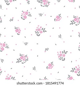 Elegant floral pattern in a small pink flower. White background. The Liberty Style. Floral seamless background for fashion prints. Seamless vector texture. Spring bouquet.