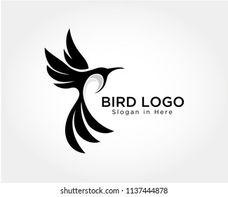 elegant Flying bird art logo