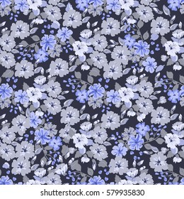Elegant gentle trendy pattern in small-scale blue flower. Millefleurs. Liberty style. Floral seamless background for textile, fabric, covers, wallpapers, print, gift wrap and scrapbooking.