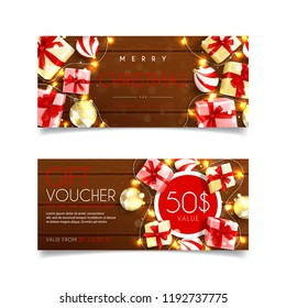 Elegant gift voucher for Christmas sale. Top view on gift boxes, garland and Christmas balls on wooden texture. Vector illustration. Design of Discount Coupon Usable for Invitations and Tickets.