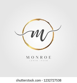 Elegant Initial Letter Type M Logo With Gold Circle Brushed