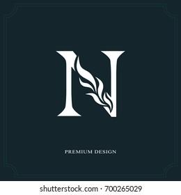 Elegant letter N. Graceful royal style. Calligraphic beautiful logo. Vintage drawn emblem for book design, brand name, business card, Restaurant, Boutique, Hotel. Vector illustration