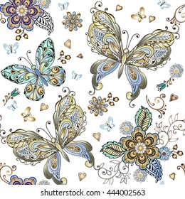 Elegant seamless pattern with gold and blue butterflies. Vintage flowers seamless ornament in gold and blue colors. Decorative ornament backdrop for fabric, textile, wrapping paper.